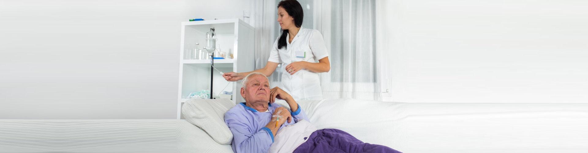 nurse checking elder man's dextrose level